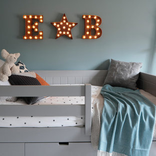 Design ideas for a small scandinavian children's room in Hertfordshire with blue walls.