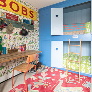 Small bohemian children's room for boys in Hampshire with carpet, beige floors and multi-coloured walls.