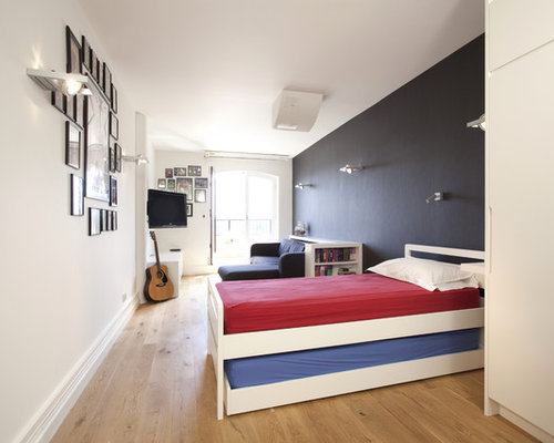 Trendy gender neutral light wood floor and beige floor kids  room photo in  London. Teen Girl Bedroom Furniture   Houzz
