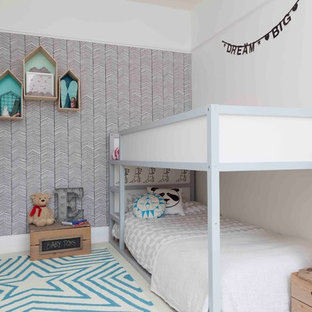 Photo of a medium sized contemporary gender neutral children's room in London with white walls and carpet.