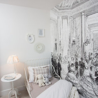 Inspiration for a shabby-chic style children's room for girls in Manchester with carpet, white walls and beige floors.