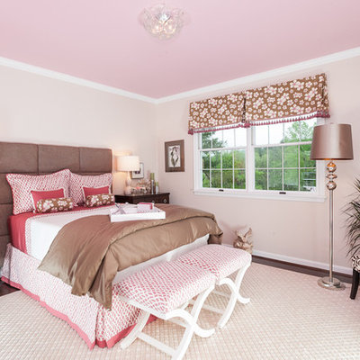 Elegant girl carpeted and beige floor kids' room photo in Baltimore with pink walls
