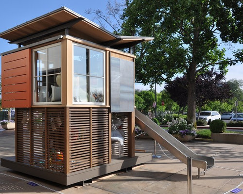11 extraordinary playhouses that dream big for Big kids play house