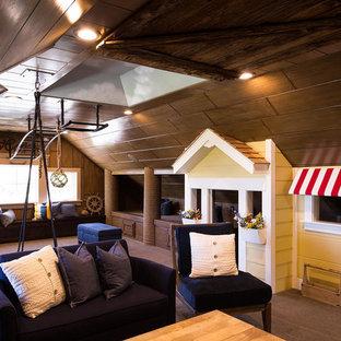 Immagine di un'ampia cameretta per bambini stile americano con moquette e pareti multicolore