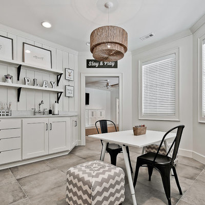 Eclectic gray floor playroom photo in Other with white walls