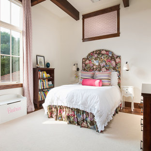 Tuscan medium tone wood floor and brown floor kids' bedroom photo in Austin with white walls