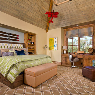 Kids' room - traditional boy medium tone wood floor kids' room idea in Dallas with beige walls
