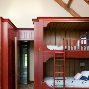 Inspiration for a large transitional gender-neutral carpeted kids' room remodel in Other with beige walls