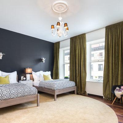 Large trendy gender-neutral medium tone wood floor kids' room photo in New York with multicolored walls