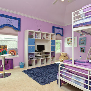 Example of a trendy kids' room design in Houston with purple walls