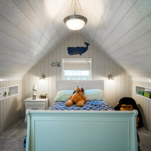 Kids' room - coastal boy carpeted and gray floor kids' room idea in New York with gray walls
