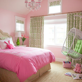 Mid-sized traditional kids' bedroom in Los Angeles with pink walls and carpet for girls.