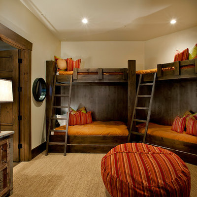 Example of a classic gender-neutral carpeted and beige floor kids' room design in Salt Lake City with beige walls