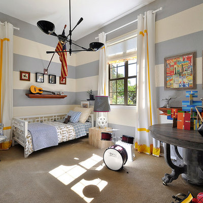Inspiration for a contemporary boy carpeted and beige floor kids' room remodel in Austin with multicolored walls