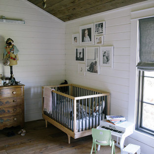 Kids' room - country girl medium tone wood floor kids' room idea in Nashville with white walls