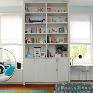Inspiration for a contemporary girl medium tone wood floor kids' room remodel in New Orleans with blue walls