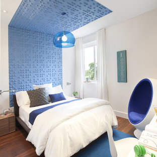 Inspiration for a contemporary kids' room remodel in Miami with multicolored walls