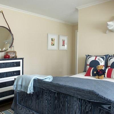 Kids' room - mid-sized transitional boy dark wood floor and brown floor kids' room idea in DC Metro with beige walls
