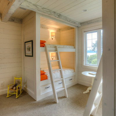 Example of a classic gender-neutral carpeted kids' room design in Seattle with beige walls