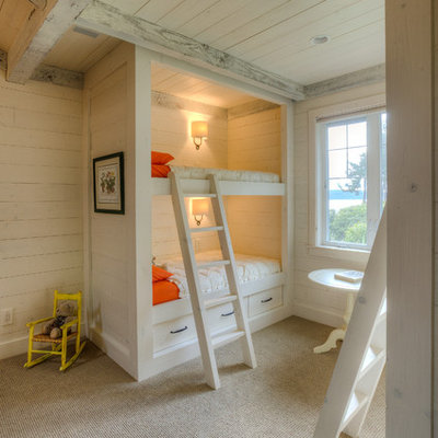 Example of a mountain style gender-neutral carpeted kids' room design in Seattle with white walls