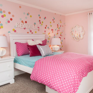 Example of a classic girl carpeted kids' bedroom design in San Francisco with pink walls