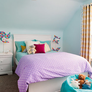 Example of a classic girl carpeted kids' bedroom design in San Francisco with blue walls