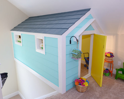 Small traditional gender-neutral kids' room idea in Raleigh with white ...