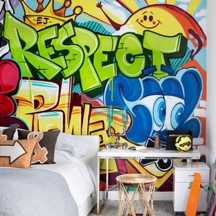 Eclectic boy carpeted and gray floor kids' room photo in Miami with multicolored walls