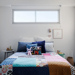 Photo of a large contemporary gender-neutral kids' bedroom in Melbourne with carpet, grey floor and white walls.