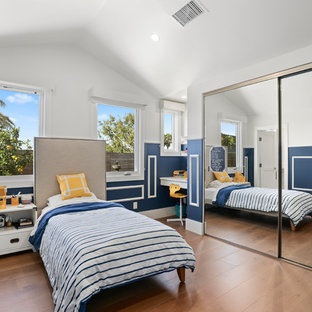 Inspiration for a transitional gender-neutral medium tone wood floor kids' room remodel in Orange County with blue walls