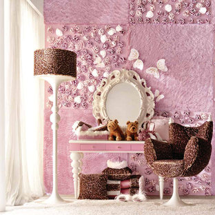 Example of a large minimalist girl carpeted kids' room design in London with pink walls