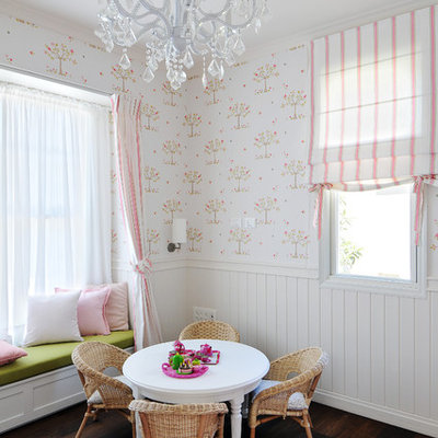 Example of a classic girl dark wood floor kids' room design in Other with white walls