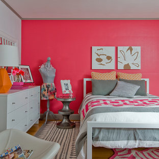 Example of a mid-sized eclectic girl light wood floor kids' room design in Boston with pink walls