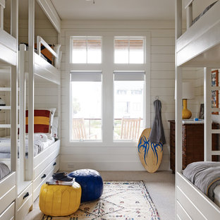 Kids' bedroom - beach style boy carpeted and beige floor kids' bedroom idea in Seattle with white walls