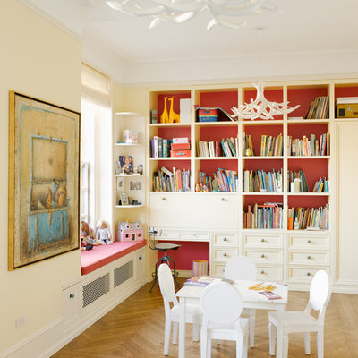 Inspiration for a mid-sized transitional gender-neutral light wood floor kids' room remodel in New York with multicolored walls