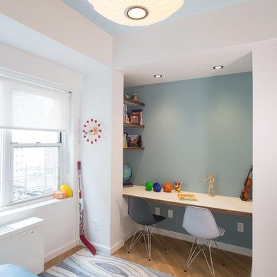 Kids' room - mid-sized modern boy light wood floor kids' room idea in New York with white walls