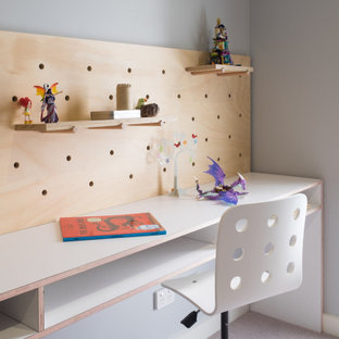 Inspiration for a mid-sized contemporary kids' study room for kids 4-10 years old and boys in Wollongong with grey walls, carpet and grey floor.