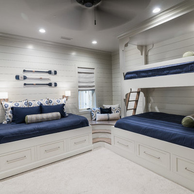 Kids' room - mid-sized coastal gender-neutral carpeted and white floor kids' room idea in Other with white walls