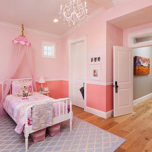 Design ideas for a traditional kids' room for girls in Phoenix with pink walls and light hardwood floors.