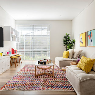 Inspiration for a contemporary gender-neutral kids' playroom for kids 4-10 years old in Perth with white walls, medium hardwood floors and brown floor.