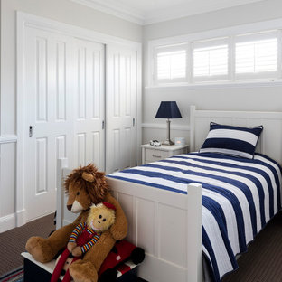 This is an example of a traditional kids' room in Brisbane with grey walls, carpet and grey floor.