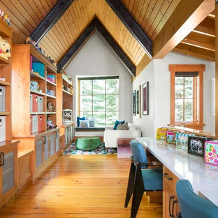 Inspiration for a rustic gender-neutral medium tone wood floor childrens' room remodel in Denver with white walls