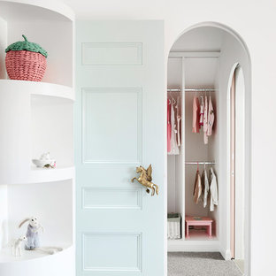 Inspiration for a scandinavian toddler room for girls in Melbourne with white walls, carpet and grey floor.