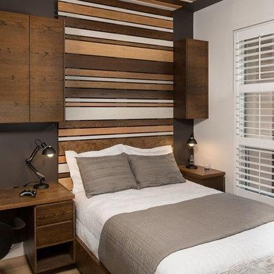 Mid-sized minimalist boy medium tone wood floor and brown floor kids' room photo in Toronto with multicolored walls