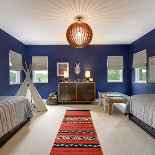 Kids' room - large transitional boy carpeted and beige floor kids' room idea in Austin with blue walls