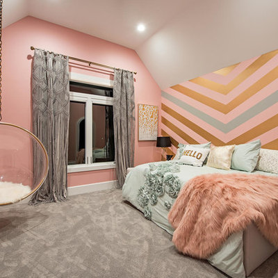 Example of a mid-sized transitional girl carpeted and gray floor kids' room design in Cleveland with multicolored walls