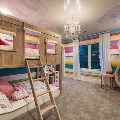 Inspiration for a mid-sized transitional girl carpeted and gray floor kids' room remodel in Cleveland with multicolored walls