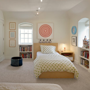 Example of a trendy boy carpeted and beige floor kids' room design in San Francisco with white walls