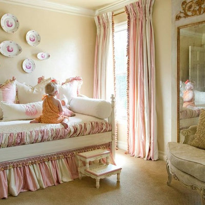 Inspiration for a timeless girl carpeted kids' room remodel in Little Rock with beige walls