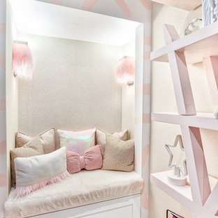 Inspiration for a mid-sized modern girl carpeted and white floor kids' room remodel in New York with pink walls
